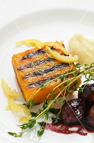 Grilled Muscade de Provence pumpkin with preserved lemons, Port wine onions and mashed potatoes with sheep's cream cheese