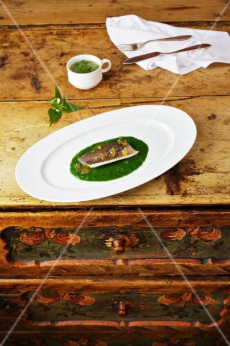 Char on a bed of stinging nettles with a dock leaf broth