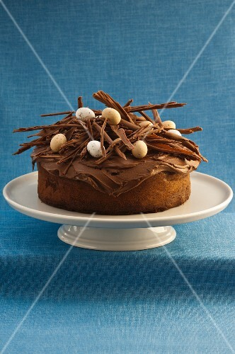 French chocolate cake decorated with chocolate curls and sugar eggs