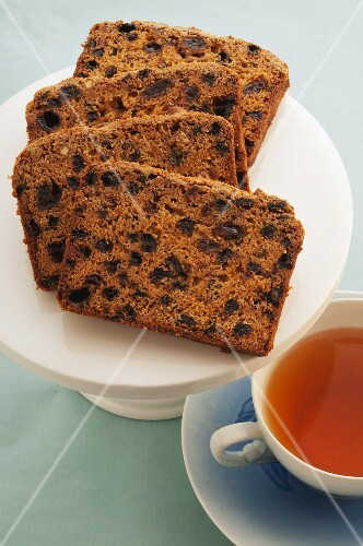 Spiced raisin cake with a cup of tea