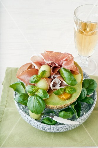 Melon with ham, mango puree and basil