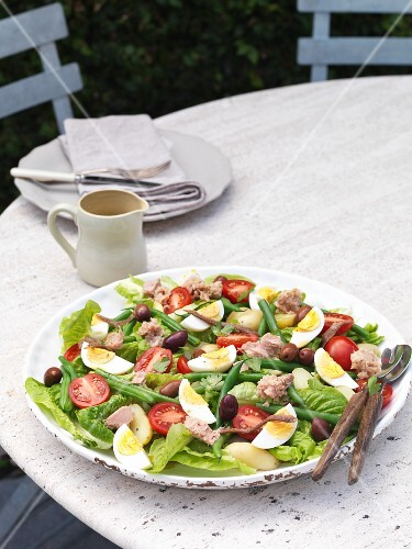 Nizza salad on a garden table
