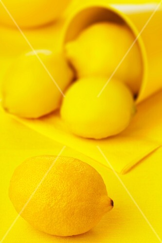 Lemons on a yellow surface