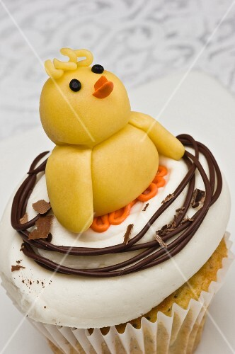 A cupcake decorated with and Easter chick