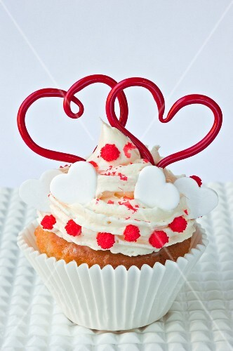 A cupcake decorated with hearts for Valentine's Day
