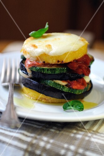 Baked polenta and mixed vegetable stack topped with cheese
