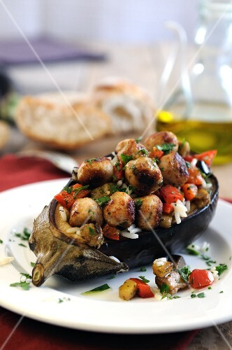 Baked aubergines stuffed with rice, roasted sweet peppers and mini lamb meatballs