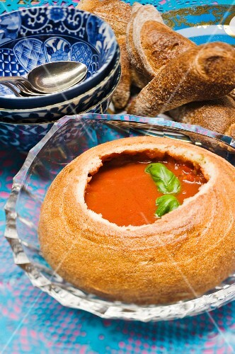 Pepper-pumpkin soup served in a hollowed out bread loaf