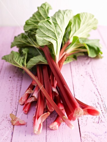 Fresh rhubarb on a wooden surface