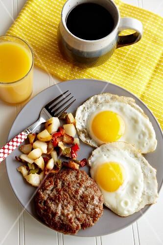 Buffalo Breakfast Sausage with Sunny Side Up Eggs; Coffee and Orange Juice