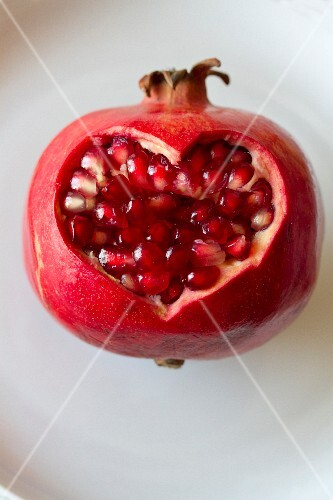 A pomegranate with a heart-shaped cut-out