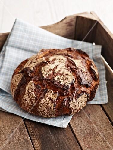 Farmhouse bread baked with a dark crust