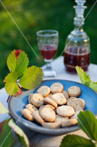 Honey and almond biscuits and homemade strawberry liqueur