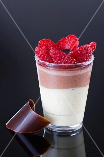 Layered dessert made with vanilla cream, chocolate mousse and fresh strawberries