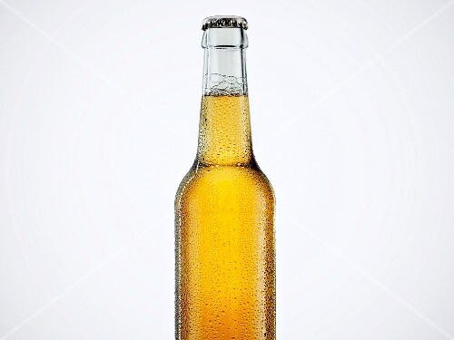 A bottle of beer with a bottle cap