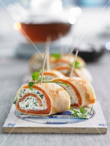 Pancake rolls with smoked salmon and herb cream cheese