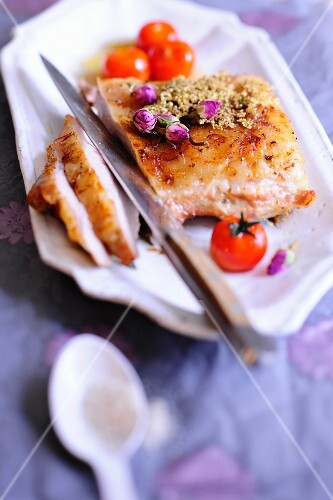 Roast veal with rose buds and cherry tomatoes