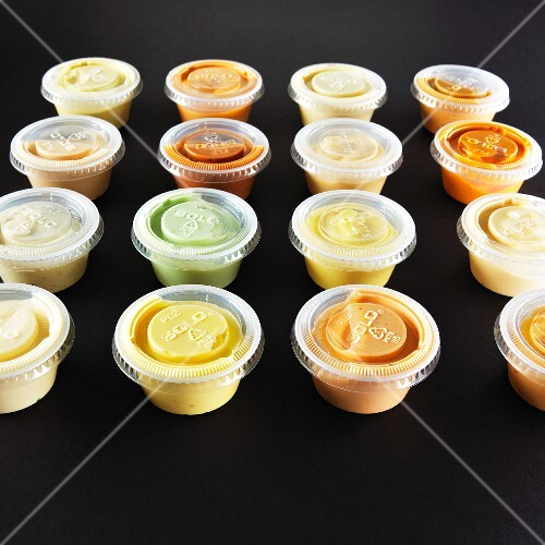 Various dips in small plastic bowls
