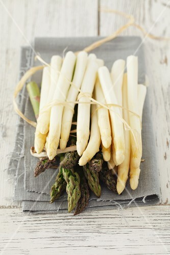 White and green asparagus on a cloth