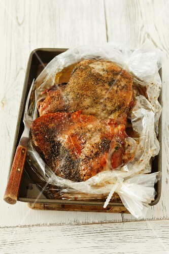 Roasted turkey leg in a roasting bag