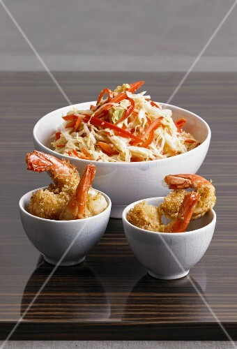 Oriental cabbage salad and fried prawns in bowls