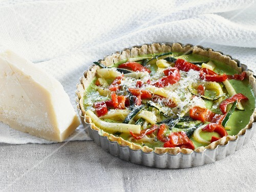 Courgette and pepper quiche in a dish
