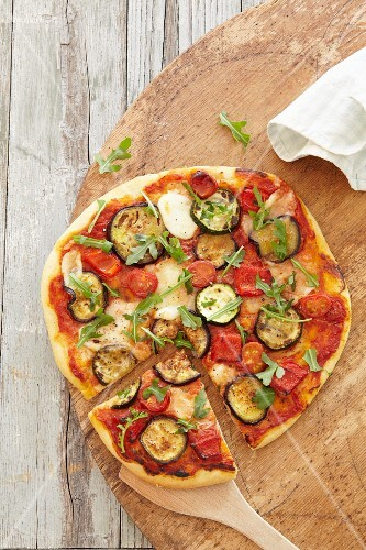 A vegetables pizza with tomato and courgette