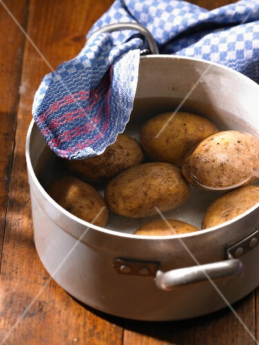 Potatoes in a pot of water
