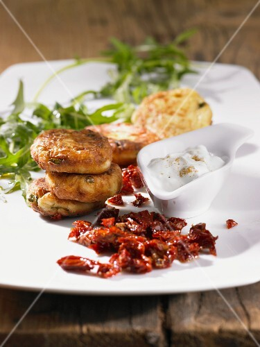 Vegetable fritters with a dip and dried tomatoes