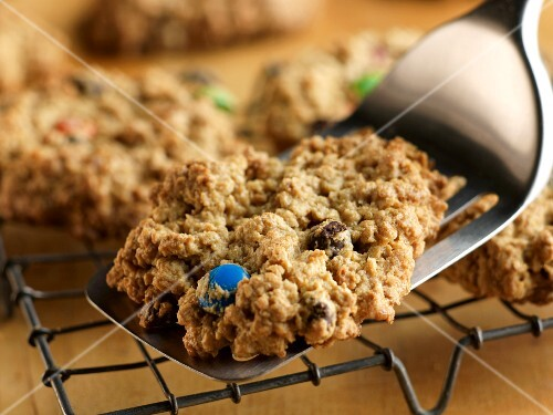 Placing M&M Cookie on a Cooling Rack with a Spatula