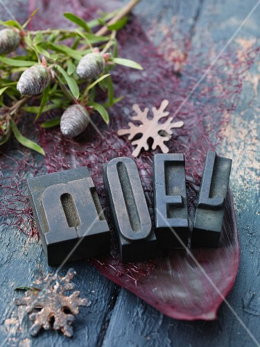 Christmas decorations with letters, pine cones and snowflakes