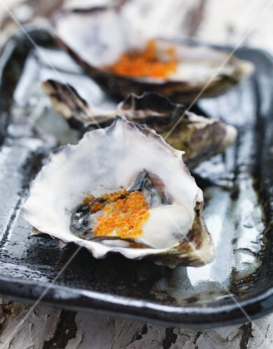 Oysters with salmon caviar