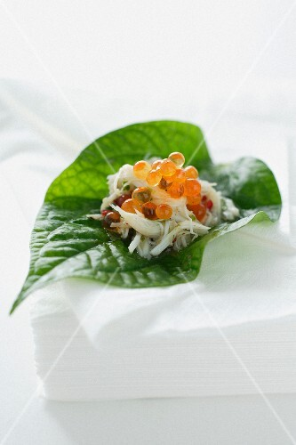 Crab and salmon caviar on a betel pepper leaf