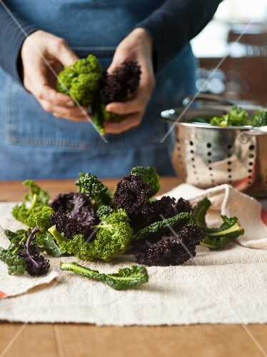 Woman Preparing Kale
