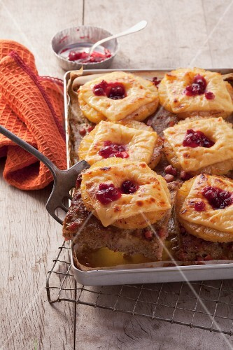 Minced meat with pineapple, cheese and lingonberries