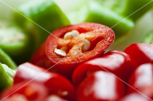 Red and green chilli peppers, sliced (close-up)