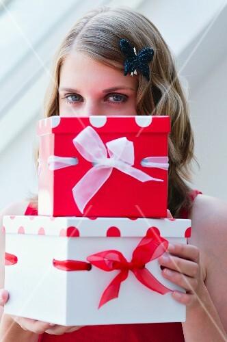 Girl holding presents