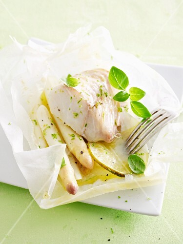 Cod with white asparagus in parchment paper