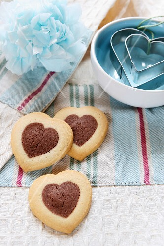 Heart-shaped biscuits and heart-shaped cutters