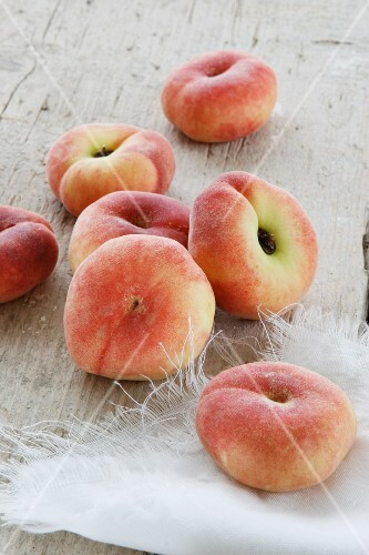 Peaches on a rustic wooden surface