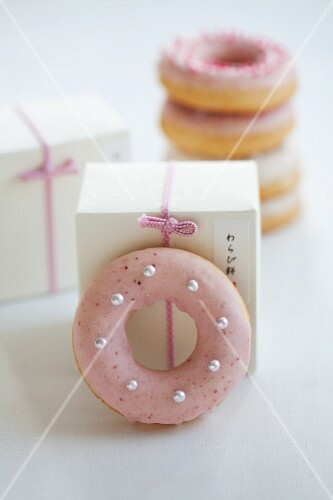 Doughnuts with pink and white sugar icing as a gift