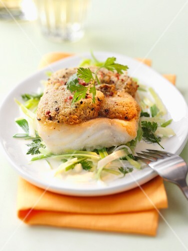 Cod fillet with a herb and nut crust on a leek medley