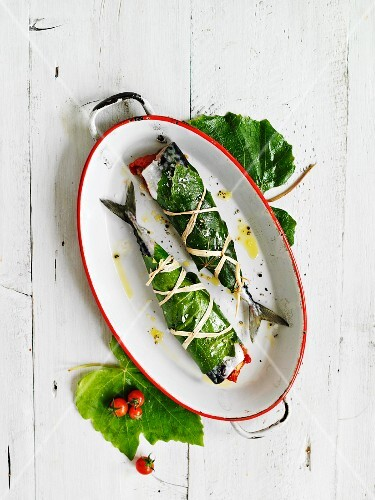 Mackerel wrapped in vine leaves with lemons