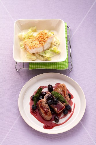 Wolffish fillet with an almond crust on pointed cabbage and tuna with olives and blueberries in red wine sauce