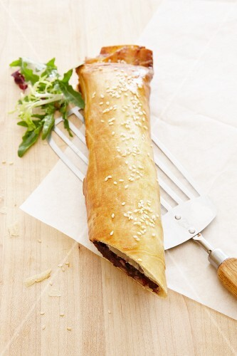 Black pudding strudel with sesame seeds