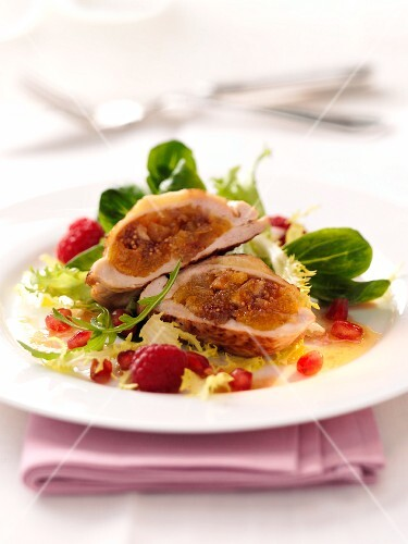 Guinea fowl with a fig filling on a fruity salad