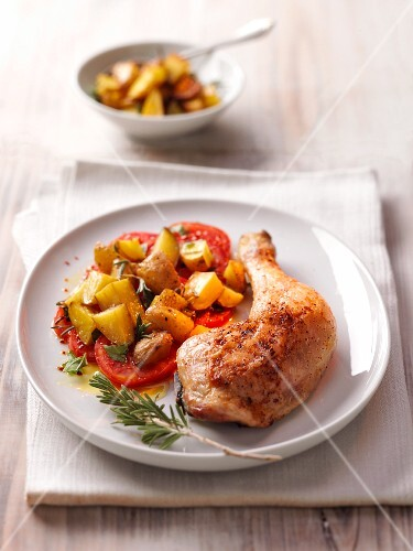 Chicken leg with a side of vegetables