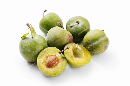 Greengages, whole and halved