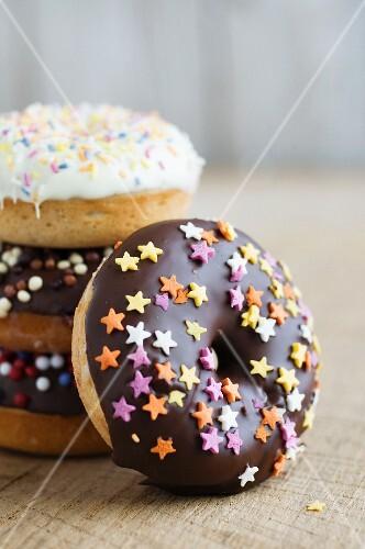 Doughnuts with dark and white chocolate glaze and sugar stars