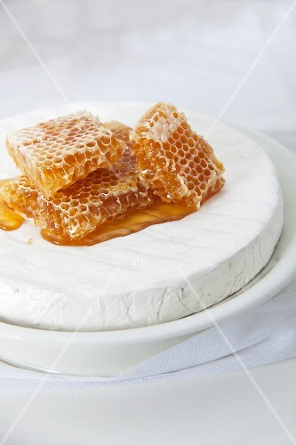 Several honeycombs on a wheel of Brie